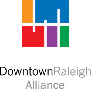 Downtown Raleigh Alliance Logo - Orange, blue, red, purple, and green city grid over sans-serif type