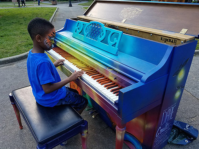 Little boy playing the art piano