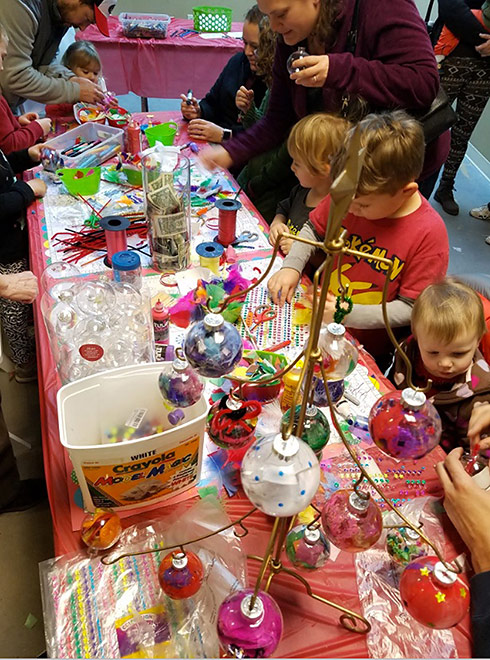 Children decorating ornaments