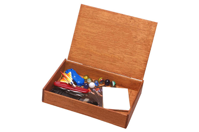 Wooden box filled with trinkets