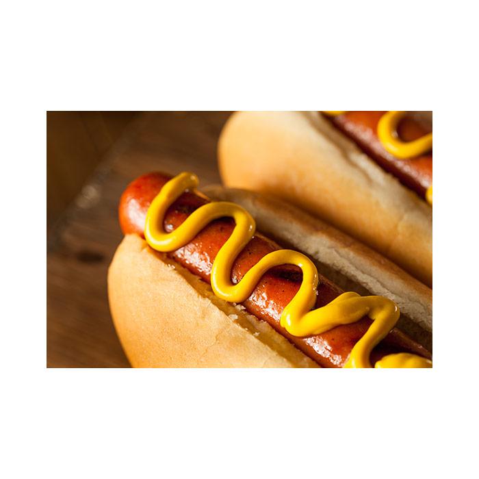 Hot dog with mustard on a bun