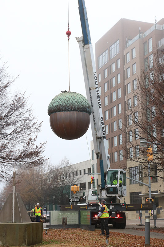 First Night Raleigh Acorn being hoisted on a crane