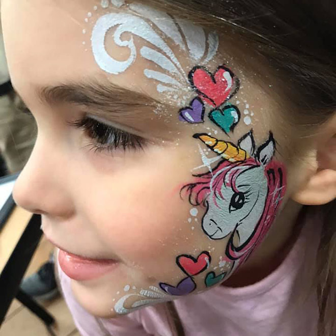 Free Spirited Artistry Face Painting - little girl with a pony painted on her face