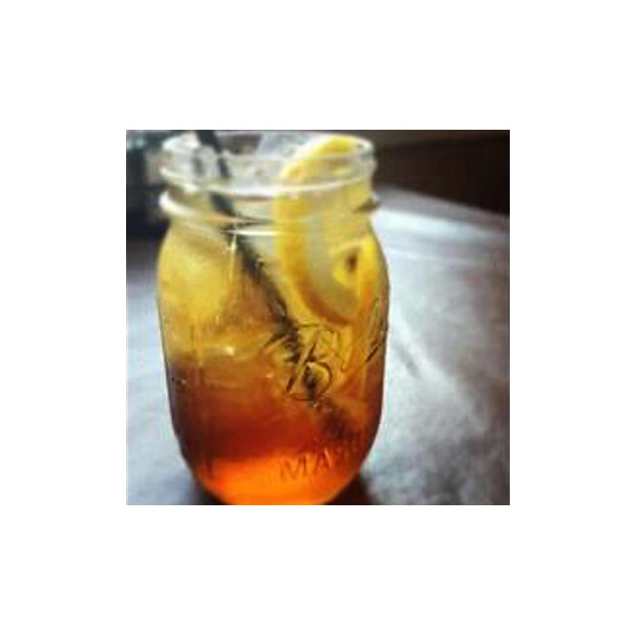 NC Sweet Tea in mason jar with lemon and straw